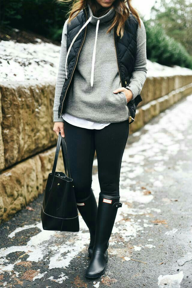 Gray hoodie with black vest, leggings and hunter boots. Casual outfit for the fall or winter. [Cozy gym purse grey snow cold days outfits inspiration]