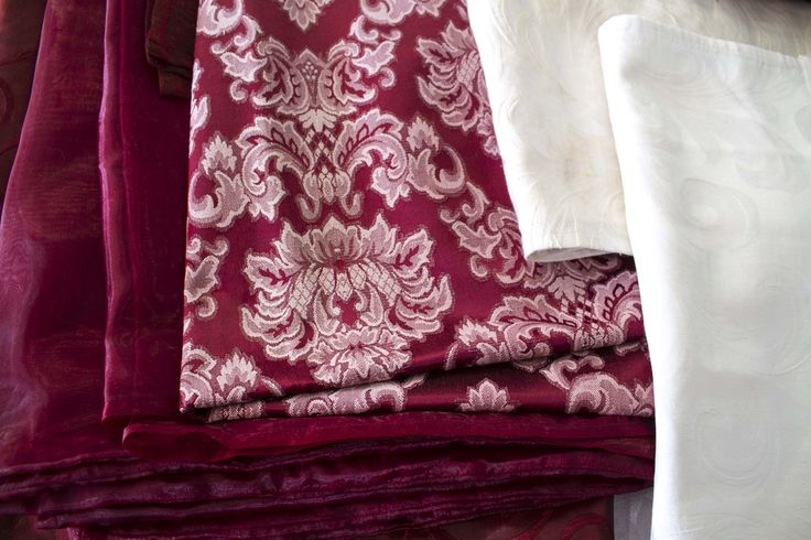 We have a big array of linens, chair covers and draping for hire. Magenta fabrics here.