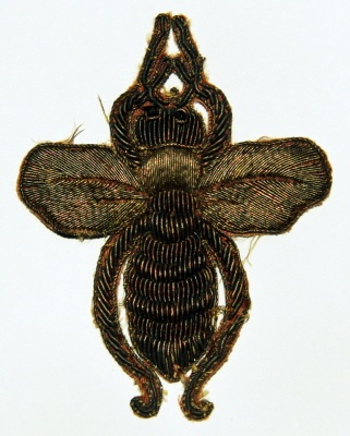 An imperial bee from the grand mantle worn by Napoleon at his coronation in 1804. (frenchempirecollection.com)
