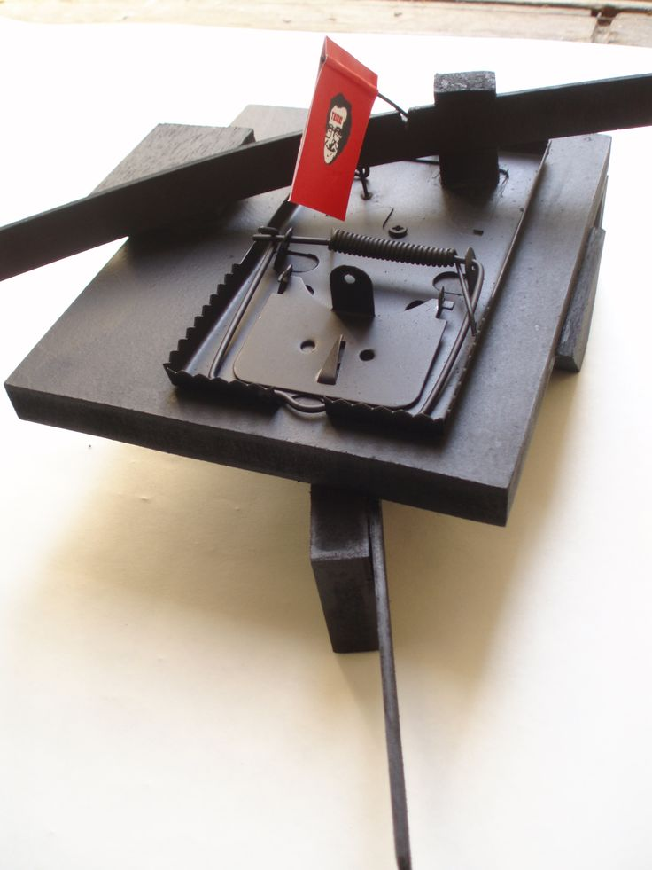 Giorgos Papadatos ,  Thinking system with mouse trap Wood,mouse trap, photocopy 70x30x15 cm,   2010