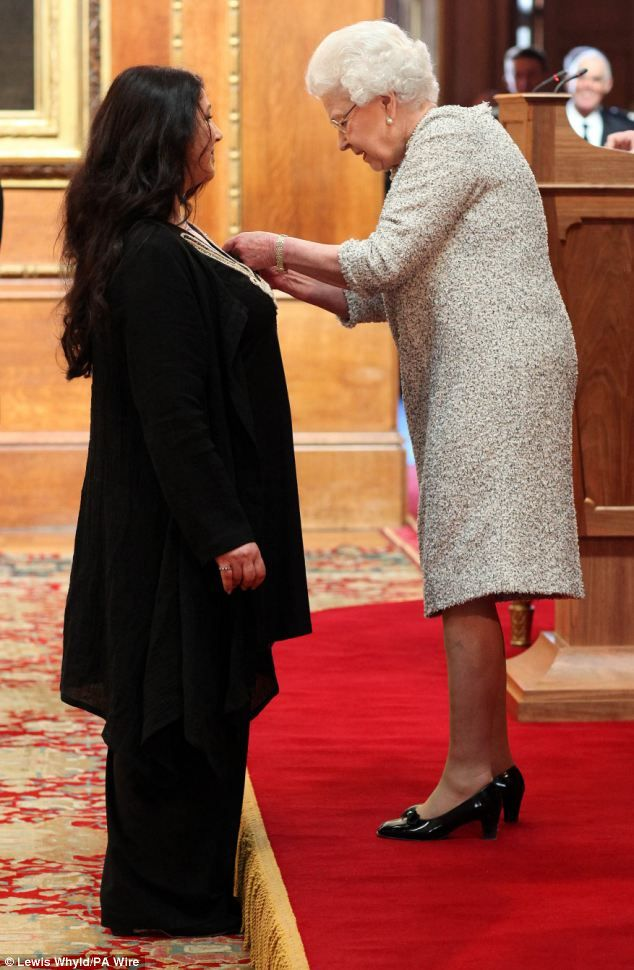 """Catherine """"Kate"""" Bush, (born 30 July 1958) being awarded Commander of the Most Excellent Order of the British Empire (CBE) by Queen Elizabeth II on 10 April 2013 at Windsor Castle. Kate was appointed Commander of the Most Excellent Order of the British Empire (CBE) in the 2013 New Year Honours, published 29 December 2012, for services to music."""