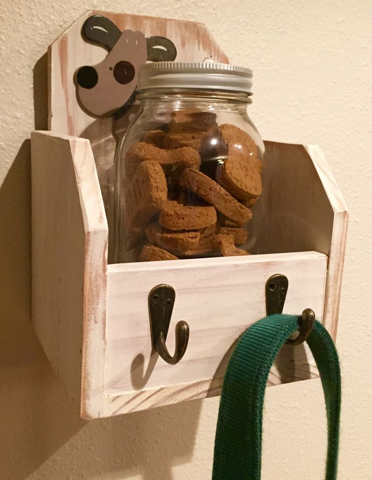A personal favorite from my Etsy shop https://www.etsy.com/listing/221893587/leash-holder-with-shelf-for-dog-treats