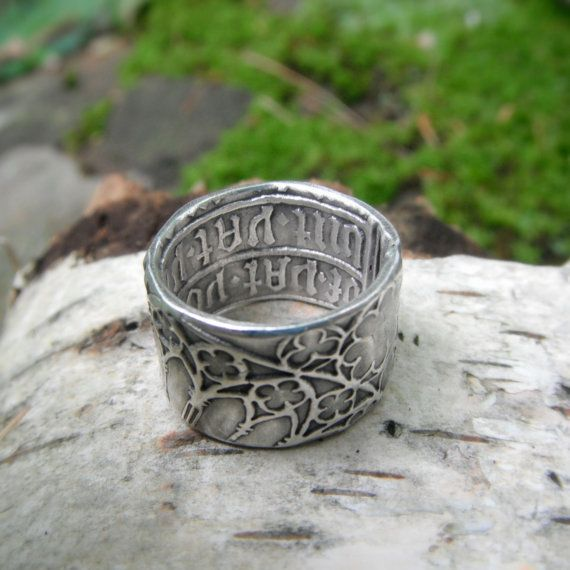 This Cathedral ring is hand formed and patterned with an intricately detailed cathedral stained glass window design on the outside. The inside is