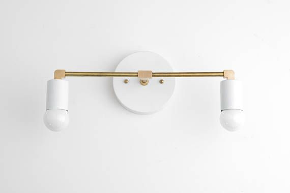 White Vanity Light - Brass Bathroom Fixture - Vanity Lighting - Vanity Sconces - Mid Century Modern - Vanity Lamps Greetings! My name is Jay Harrison and Im the lighting designer here at Mod Creation. I lead a small team of talented craftsmen with over 15 years of experience in