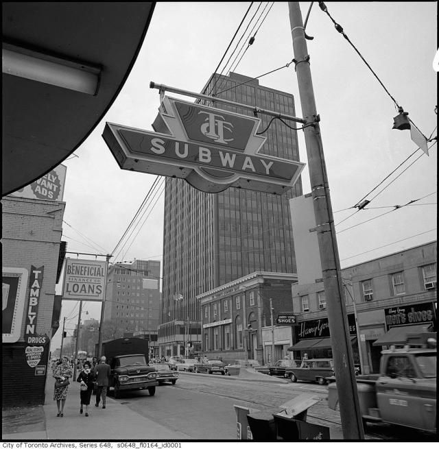 This looks to the west from in front of the entrance to the St Clair subway station, and was taken about 1960. The tall building in the centre, stands on the northwest corner of St Clair & Yonge and was the home to CFRB Radio.