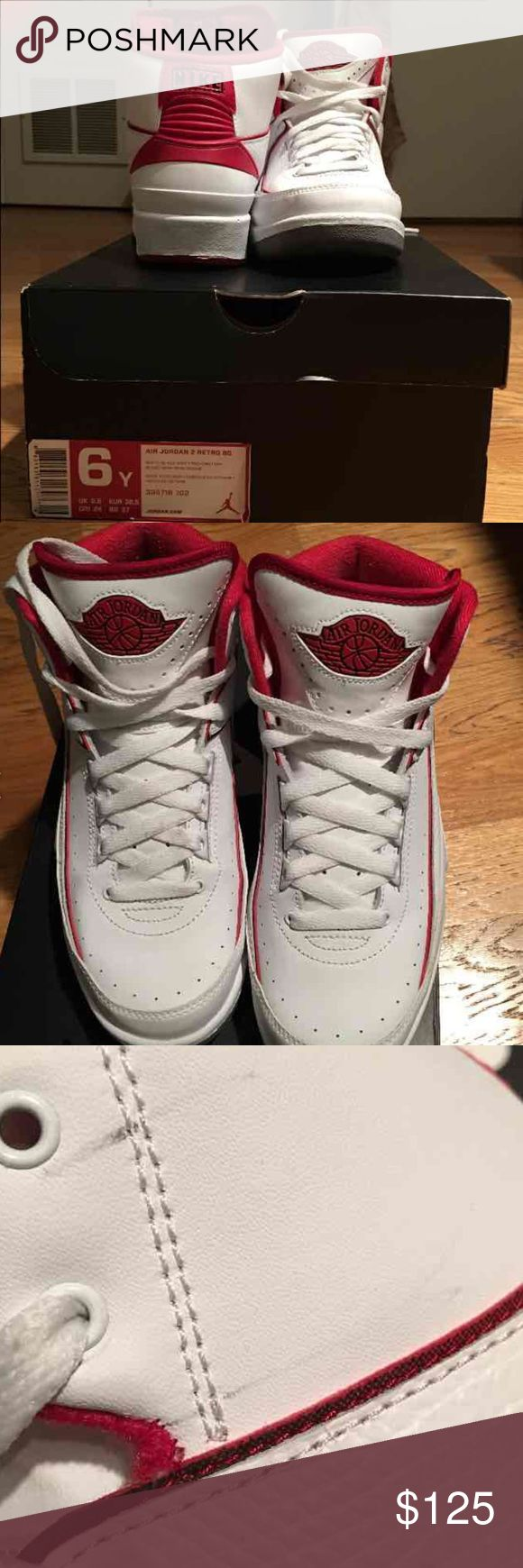 Jordan Retro 2s SIZE 6 YOUTH Jordan Retro 2 White And Varsity Red! These Are A SIZE 6 YOUTH!!!! There Are Little Marks The Left Side Of The Left Shoe That Can More Than Likely Be Removed, And A Spot On The Right Shoe Lace That Can Be Washed Out. I Only Worse These 3 Times. NO TRADES!! Jordan Shoes Sneakers