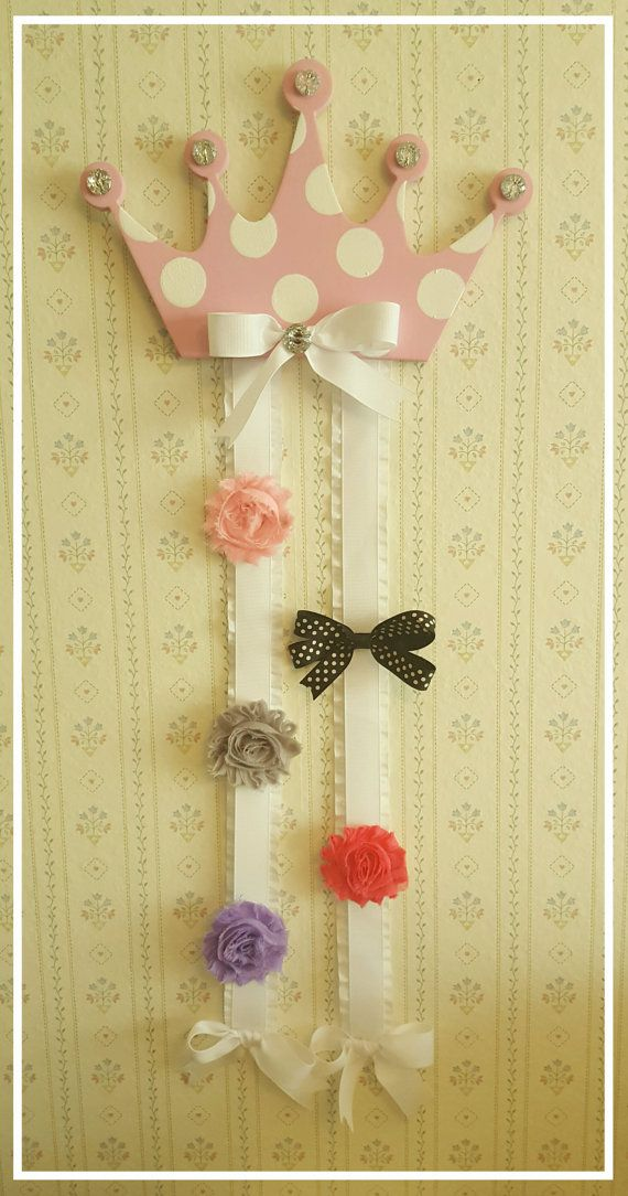 Beautiful princess crown hair bow holder makes a great shower or birthday gift or addition to your childs room or nursery. Display your adorable little ones hair bows all in one place. This holder includes two ribbon tails that are 18 each in length. The amount of hair bows/clips
