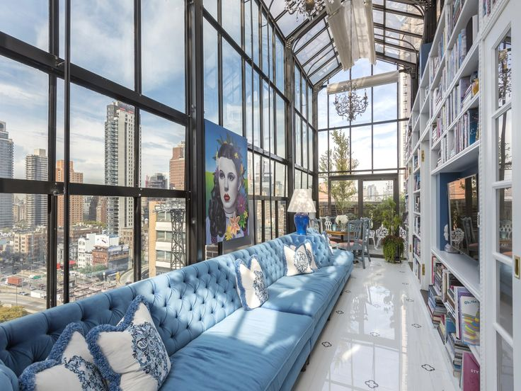 Spread out over two levels, a pre-war penthouse in New York City exemplifies exceptional execution with its colorful and stylish interior scheme.