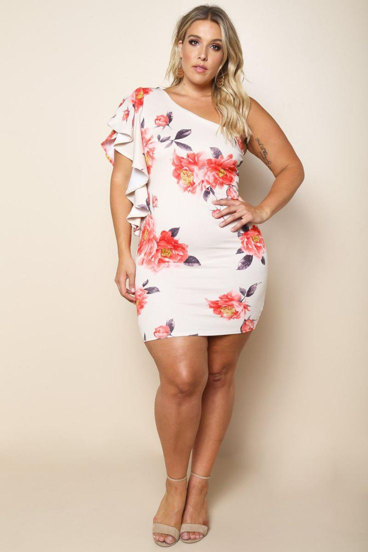 An effortlessly charming plus size mini dress with a pretty floral print fabric. Features a striking cascading ruffle design off one shoulder. Made from a body-embracing fabric and finished hem.
