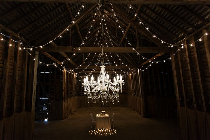 This gorgeous wedding with chandelier and festoon light combination were the perfect way to add some glamour and romance to this 18th century barn at Brickendon Barn, Tasmania - Event Avenue