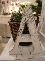 Decoupage a copy of the marriage certificate onto a Monogram!  LOVE this idea!