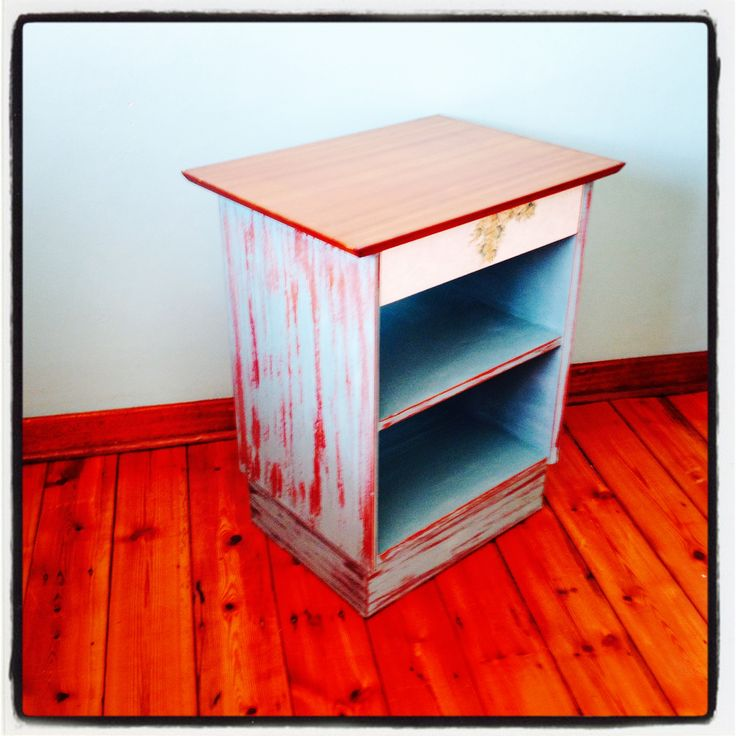 Side view of distressed side table, in Annie Sloan Provence blue chalk paint.