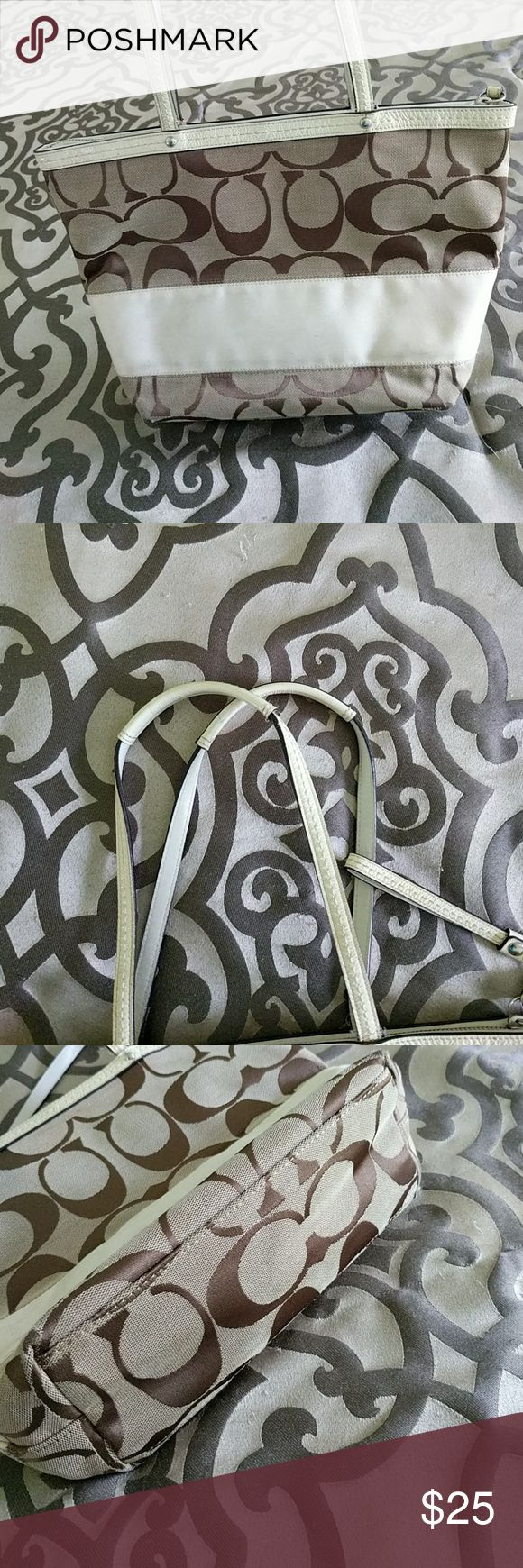 Coach purse Cream and tan Coach purse. I purchased it off of Posh but haven't use it due to I found another purse. This bag does have some light marks on it but I believe it will clean up nicely. Straps are in great condition and inside of the bag is very clean. Coach Bags Shoulder Bags