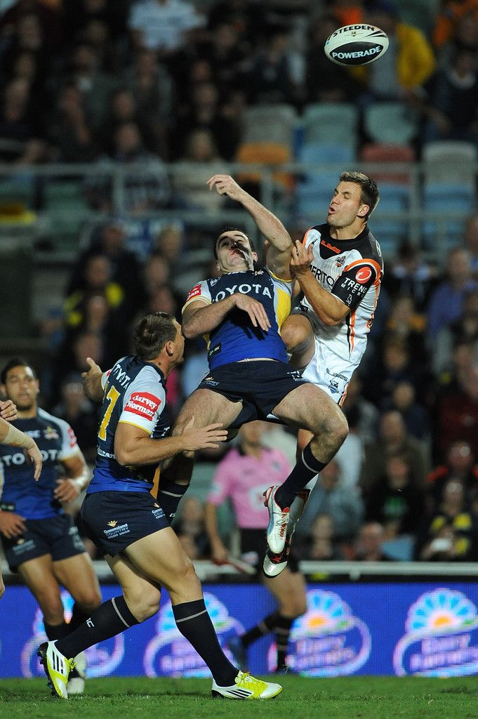 Kane Linnett of the Cowboys competes for the ball with Beau Ryan of the Tigers during the round 20 NRL match between the North Queensland Cowboys and the Wests Tigers at Dairy Farmers Stadium on July 23, 2012 in Townsville, Australia. #Sports #Rugby #NRL