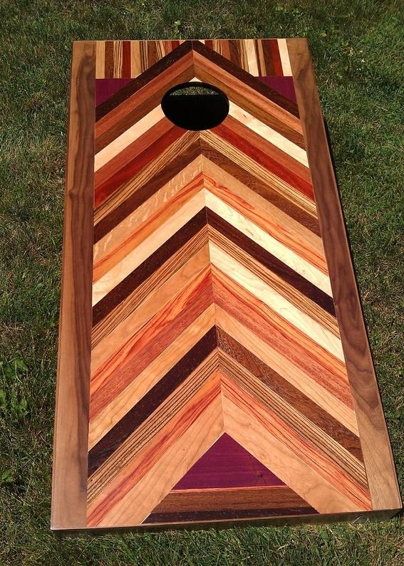 leave the ordinary behind with this custom bag board or corn board featuring exotic woods and a great striped design - Cornhole Design Ideas