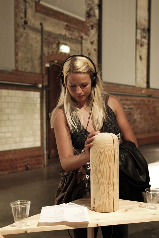 """Exhibiton with """"furuhælvetica"""" at Doga, Oslo Norway..  Here a woman is listening to the sound of pine..:) Øyvind Blikkstad recorded all of the sounds while we where working in the studio, and made the sound into """"rave"""" kind of music! pretty cool!"""