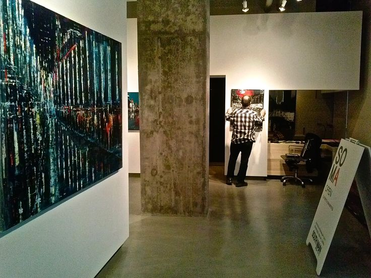 """Don M. and I Installing my """"Metropolis"""" show at South Main Gallery in Vancouver."""