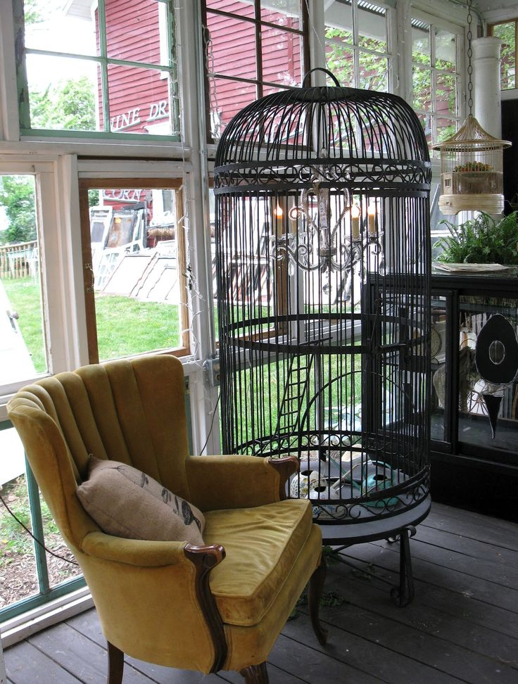 Comfy vintage chair and large birdcage ♥...found at Sisters Garden and Bloom!