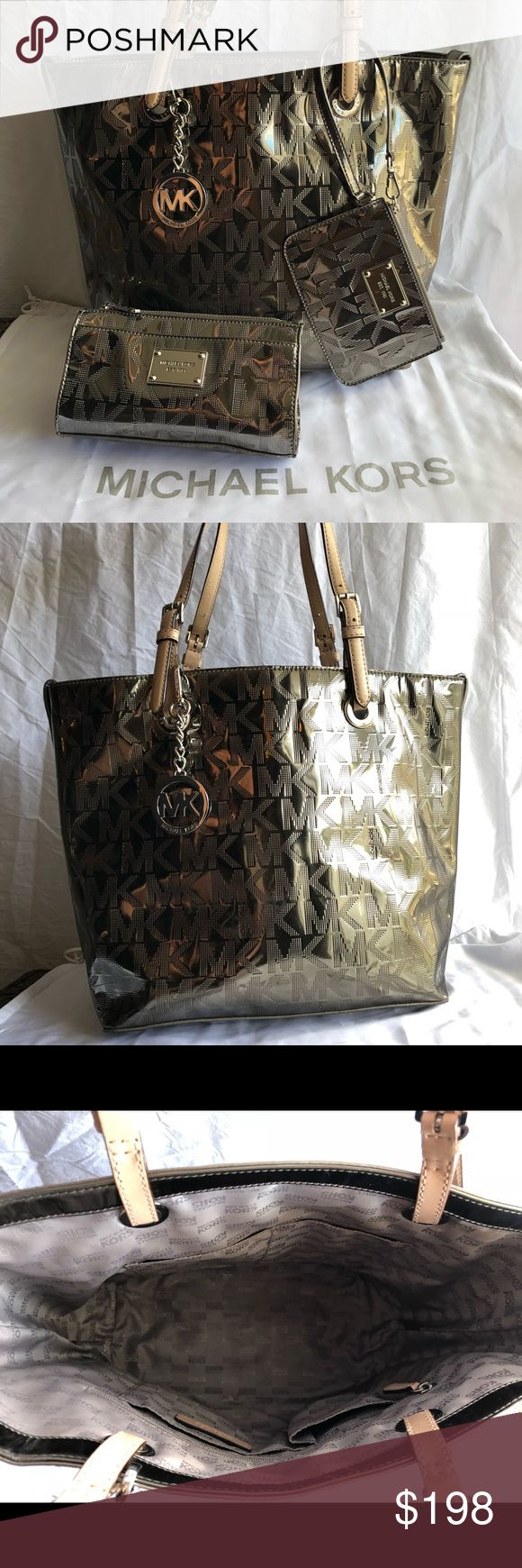 Michael Kors Metallic Purse, Wristlet & Bag:) Authentic Michael Kors Metallic Mirrored Nickel Tote/Purse New Wristlet & Cosmetic (anything Bag) Bag  EXCELLENT CONDITION:) AWESOME SET!  If you if you have any questions, message me anytime:)  Thank You for Looking! Michael Kors Bags