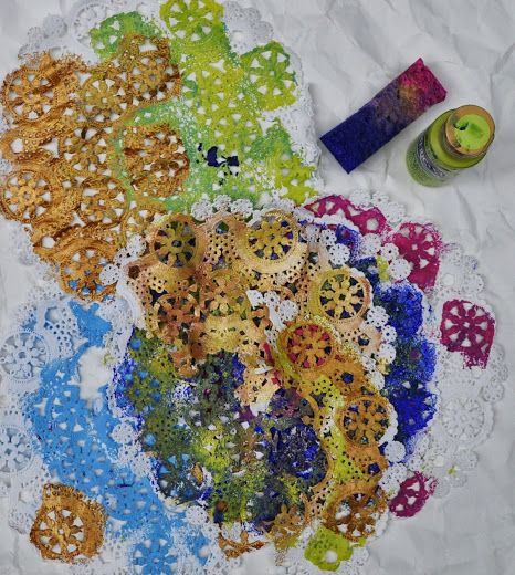 This is a simple process of using doilies as stencils.  I took a large sheet of white drawing paper and placed the doily on top of the pap...