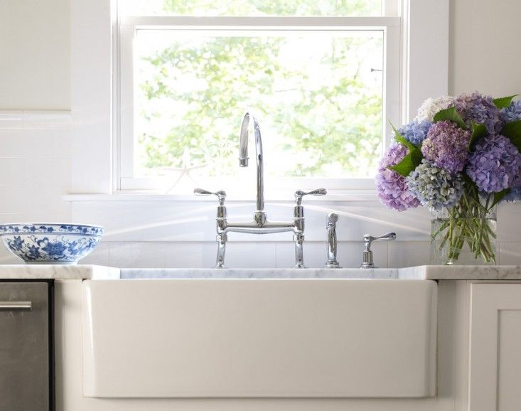 The Waterworks Easton line is the hands-down traditional faucet favorite. NYC interior designer Bella Mancini used the Easton Classic Two Hole Bridge Gooseneck Faucet with Lever Handles (starting at $1,250 in chrome)
