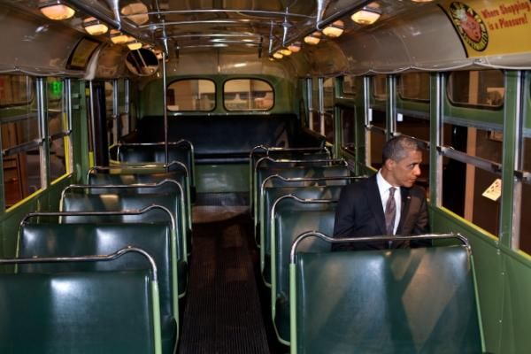 President Obama sitting on the bus seat where Rosa Park initiated her quest for civil rights.