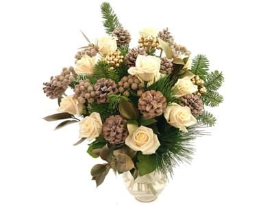 The Luxury Winter Wonder Bouquet is sure to make them merry this Christmas with its beautifully arranged off-white roses, pine cones, gold berries, and fresh seasonal greenery.