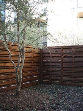 A pallet Fence!  Free Fencing material!  I need to figure this one out!