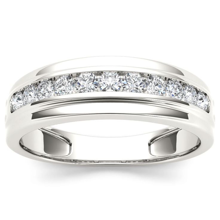 Seal your commitment to him with this white gold wedding band that is just his style. Emitting pristine brilliance at the center, five round diamonds are channel set that reflect light within the gold band.