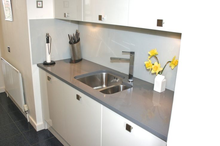 Small White Gloss Kitchen With Grey Quartz Worktop In