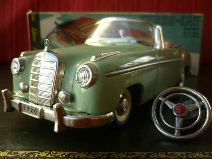 Rare green schuco 5720 tin hydro car battery operated for Mercedes benz battery warranty