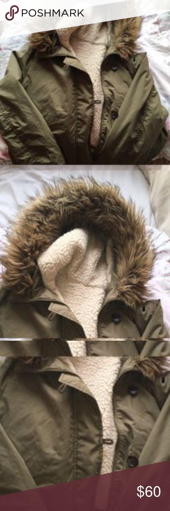 Uniqlo green utility jacket Worn a few times. It's small on me now. It's warm as it has a fleece lining inside. Uniqlo Jackets & Coats Utility Jackets
