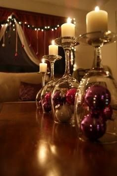 Christmas decoration ...Christmas bulbs under wine glasses, and a simple candle on top !