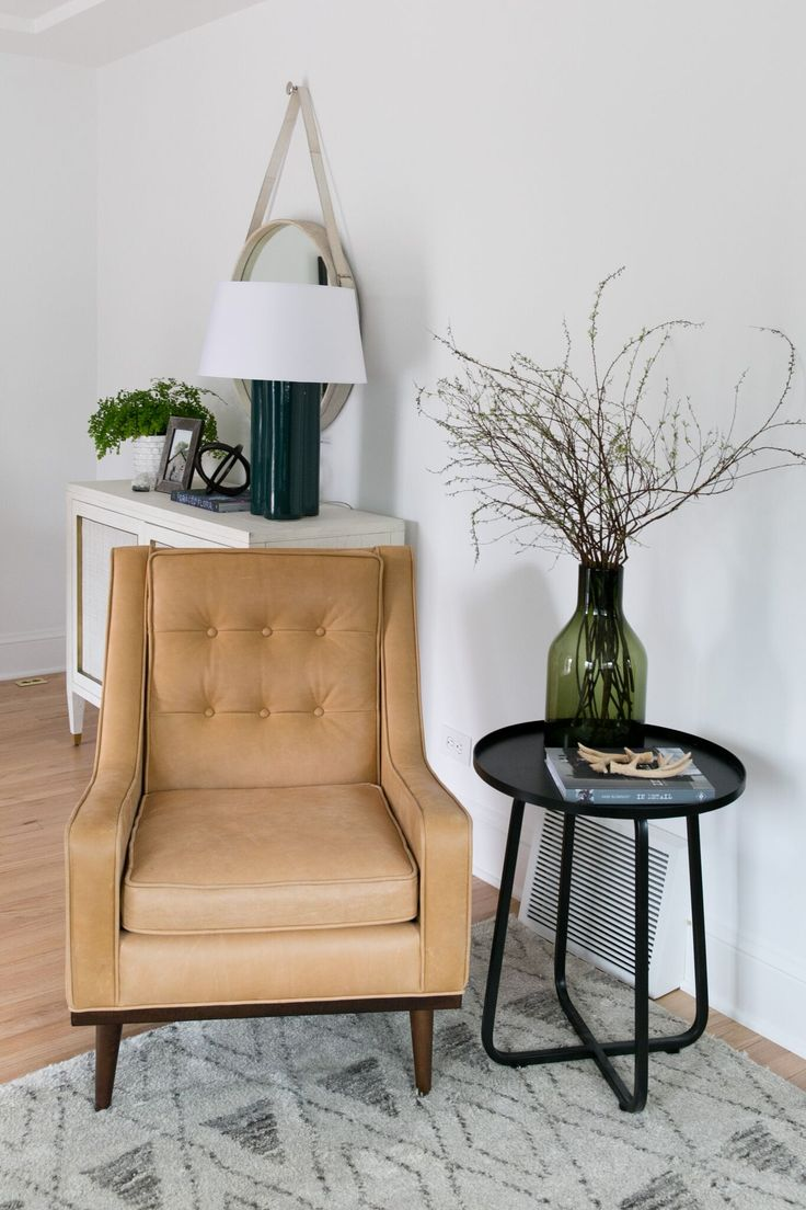 Beautiful entryway design with leather chair! Denver Tudor Project | Studio McGee