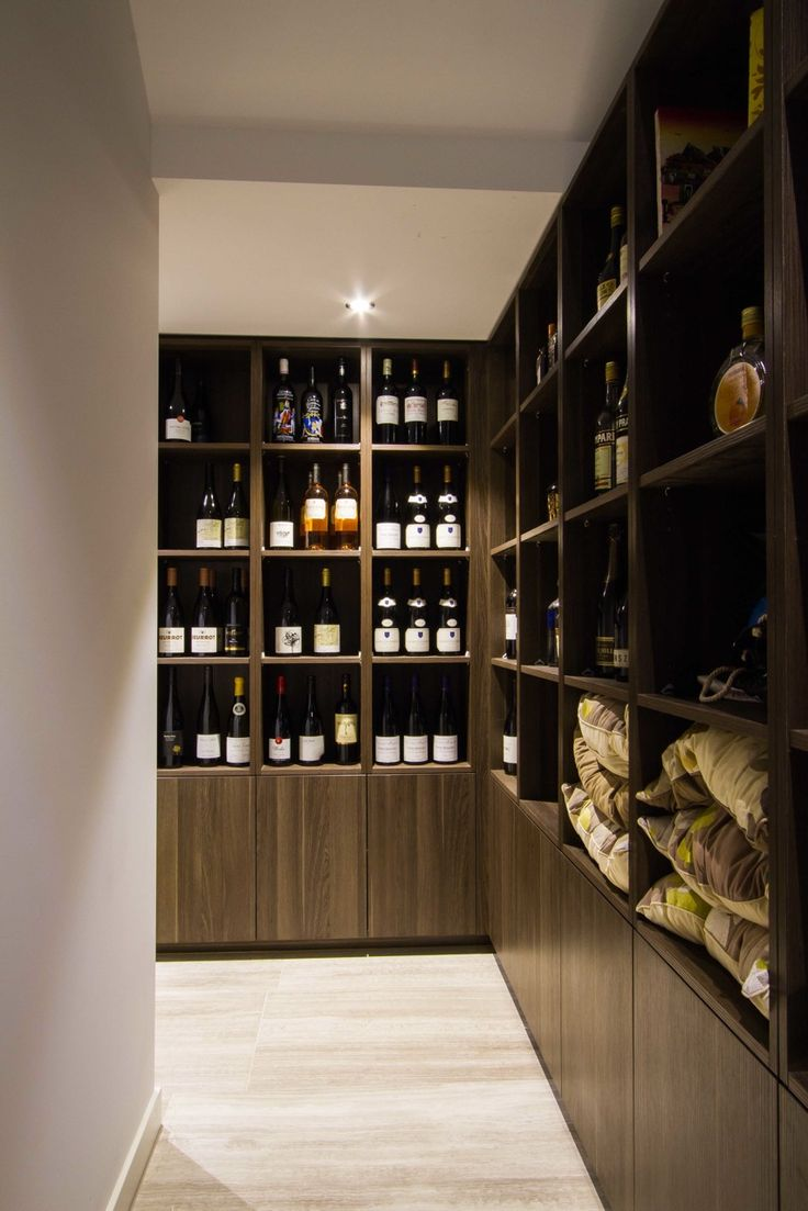 Modern handless wine cellar. www.thekitchendesigncentre.com.au @thekitchen_designcentre