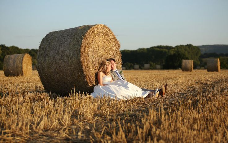 Wedding love in a harvested wheat field at Grittenham Barn