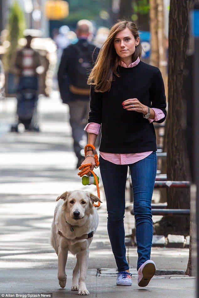 Puppy love: Allison Williams gave a reminder of her special day as she showcased her sparkling new wedding band while out and about on a stroll with her pet pooch, Moxie, in New York City on Thursday