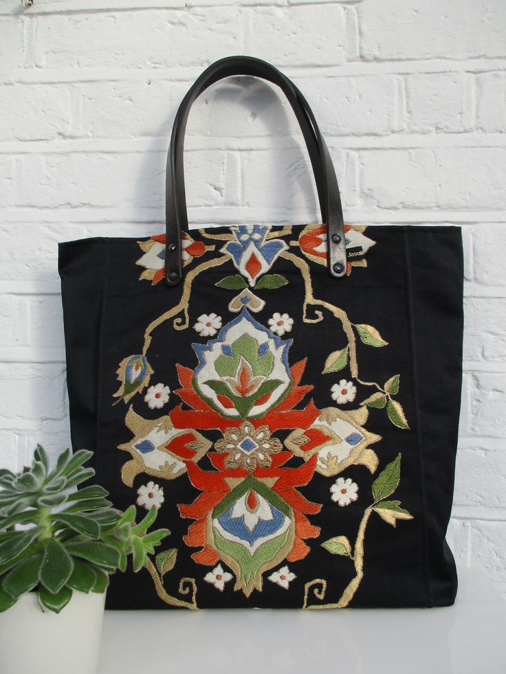 Large tote style bag made from vintage silk obi fabric in black, gold, blue, terracotta and green.