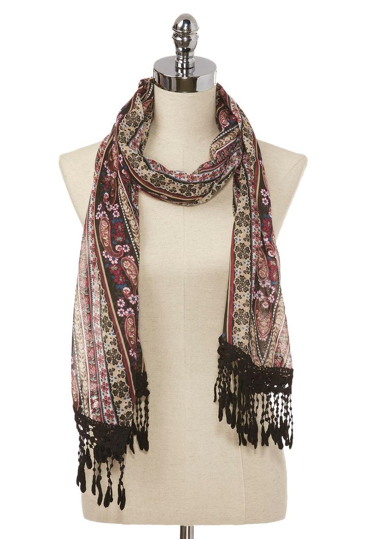 Add a feminine flourish to your look with this lightweight oblong scarf…