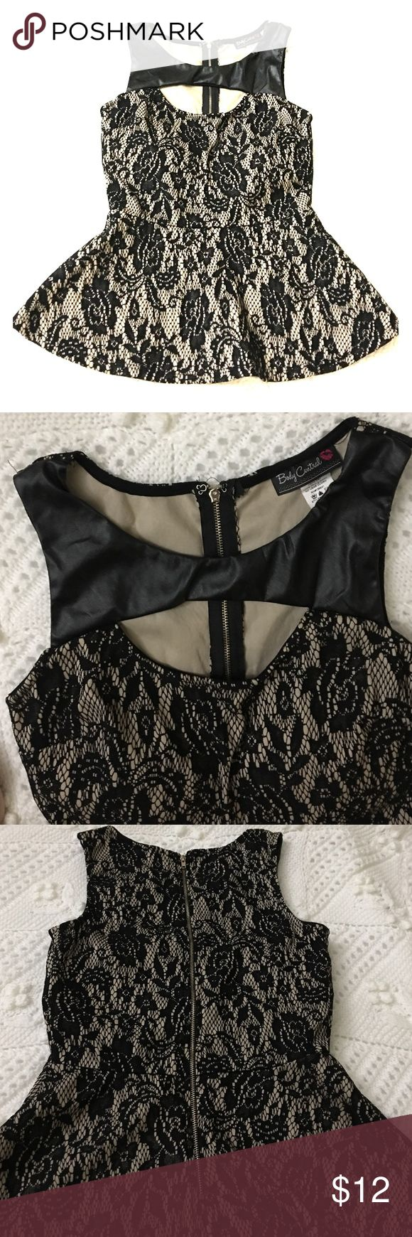 Sexy Nude Black lace peplum sz small Sexy Nude with black lace peplum top. Faux leather shoulders with cut out in front. Gold exposed zipper up back. And built in bra cups. Size small. Worn once Tops