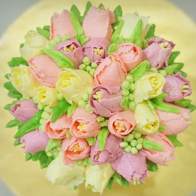 Module : Tulips Bouquet Cake Deco Student will learn how to : - Make Swiss meringue Buttercream - pipe open and close tulips - pipe baby breath flowers - arrange flowers on the cake Items provided to the students : - Victoria Sandwich Cake Recipe - Free | by Mazlea