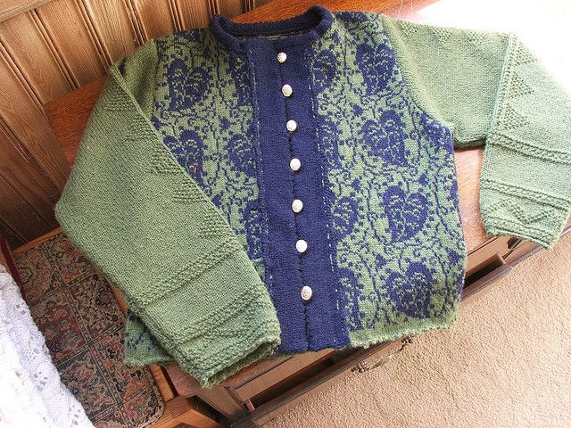 From a pattern by Solveig Hisdal Green_Cardigan_w_Leaves_on_dresser by lieslknitting, via Flickr