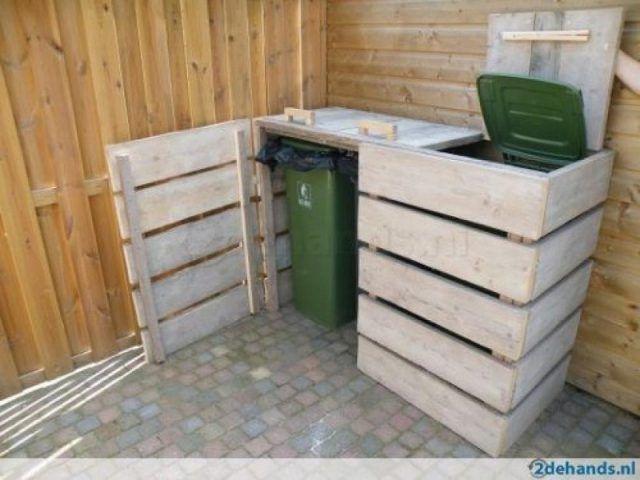 8 Magnifiques Idees Pour Decorer Votre Jardin A L Aide De Palettes De Bois Cacher Les Poubelles Rangement Exterieur Abris Poubelle
