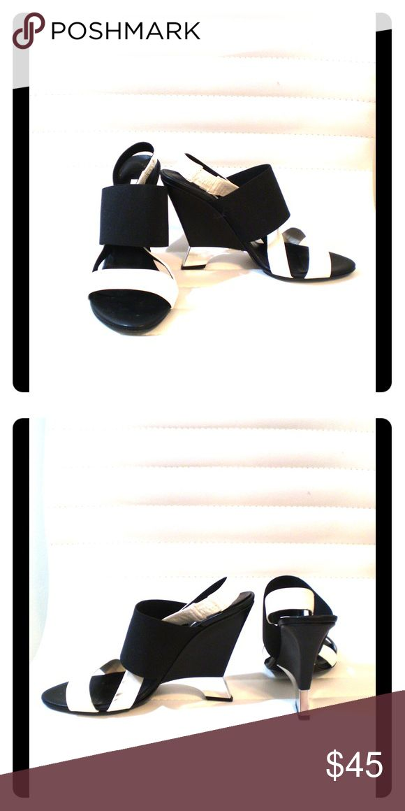 Diane von Furstenberg black/cream wedge sandals Diane von Furstenberg black and cream wedge sandals with silver detail on wedge heel. Has slight scuff marks on cream part of straps that could very likely be cleaned by a shoe repair place. Diane von Furstenberg Shoes Wedges
