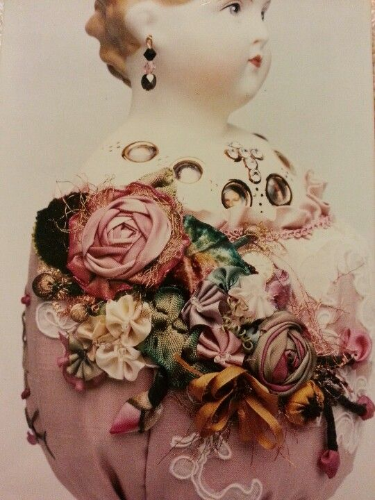 Doll and ribbon work by Roman Curbelo