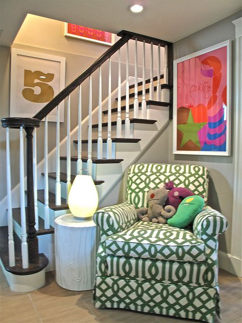 love the  dark wood stairs & handrail with the enameled. i also love these fresh, happy colors. i do believe this is a lower level.