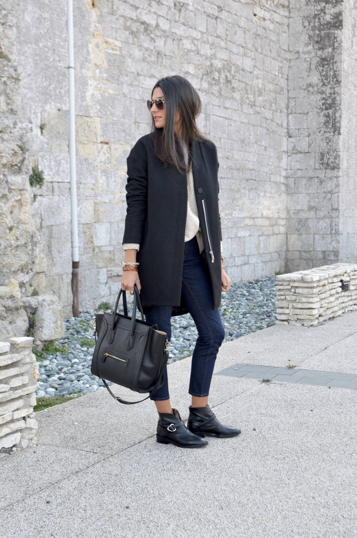 Federica L. looks cool and casual in cropped denim jeans and a black wool blend jacket. Total Look: And Other Stories.