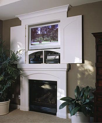 above fireplace tv hideaway Love the idea of being able to shut the tv away especially love wall mounted tv so u can still use the cupboard for other things.