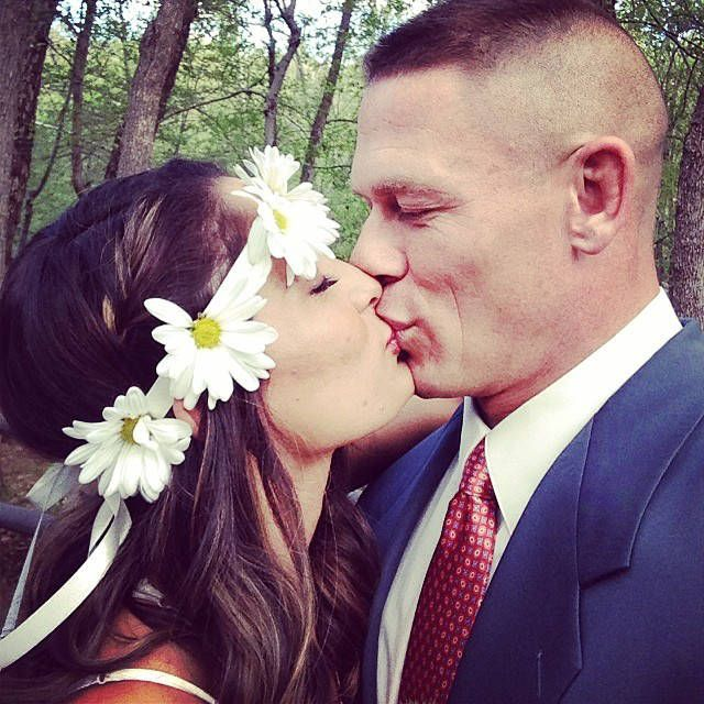 Union of Love from Nikki Bella and John Cena's Love Story Nikki and John kiss to celebrate Brie Bella's marriage to Daniel Bryan.