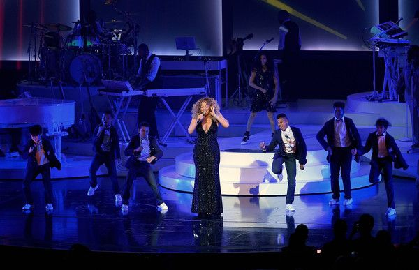 "Mariah Carey Photos - Singer/songwriter Mariah Carey (C) performs with dancers during the launch of her residency ""MARIAH #1 TO INFINITY"" at The Colosseum at Caesars Palace on May 6, 2015 in Las Vegas, Nevada. - Mariah Carey Launches 'MARIAH #1 TO INFINITY' At Caesars Palace In Las Vegas"